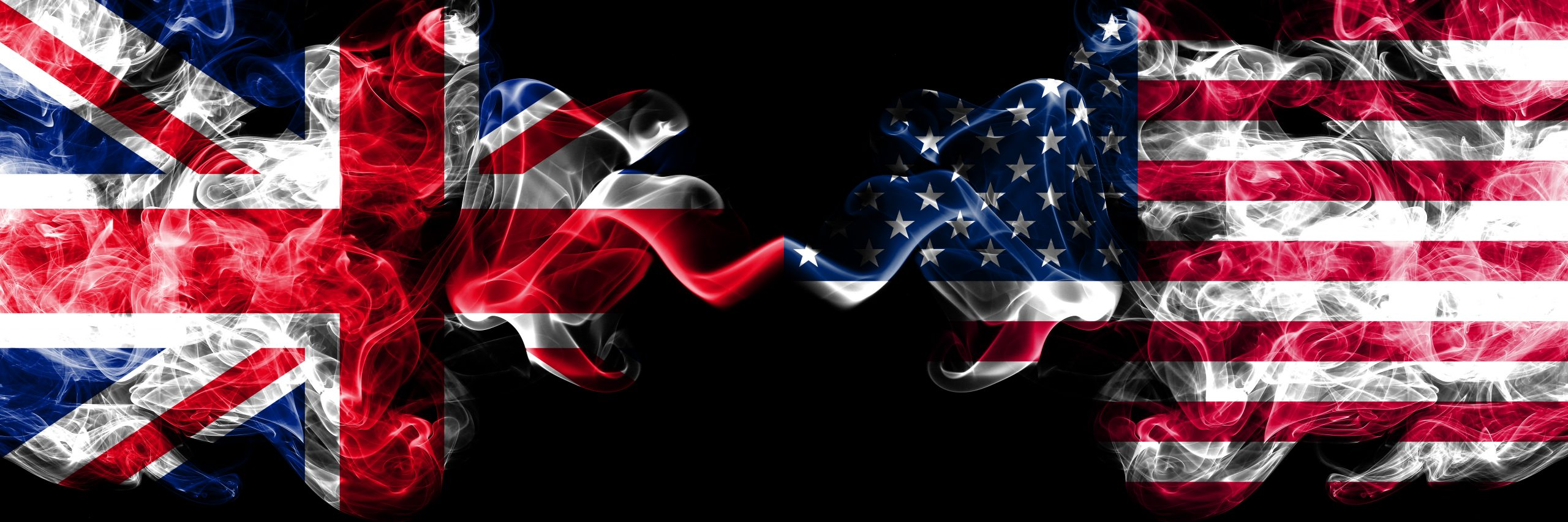 UK and US flags smoke between them